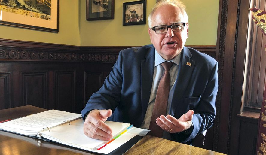 Minnesota Gov. Tim Walz discusses his plans for the 2020 legislative session and other issues in an interview with The Associated Press on Tuesday, Sept. 17, 2019 in his office at the state Capitol in St. Paul, Minn. (AP Photo/Steve Karnowski)