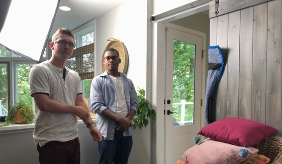 """Tyler Berryman (left) and Isaiah Dixon, standing in a home in Arnold, Maryland, on June 16, 2019, are featured in a video series called """"Understand AD Squad,"""" a national campaign to raise awareness about atopic dermatitis, a form of eczema. (Shen Wu Tan / The Washington Times)"""