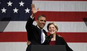 President Barack Obama waves to supporters as he hugs Massachusetts senatorial candidate Elizabeth Warren before addressing supporters during a campaign fundraiser at Symphony Hall in Boston, Monday, June 25, 2012. (AP Photo/Stephan Savoia)