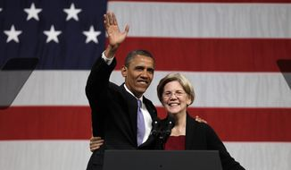 President Barack Obama waves to supporters as he hugs then-Massachusetts senatorial candidate Elizabeth Warren before addressing supporters during a campaign fundraiser at Symphony Hall in Boston, Monday, June 25, 2012. (AP Photo/Stephan Savoia) ** FILE **