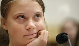 Youth climate change activist Greta Thunberg, left, attends a House Foreign Affairs Committee subcommittee hearing on climate change Wednesday, Sept. 18, 2019, on Capitol Hill in Washington. (AP Photo/Jacquelyn Martin)