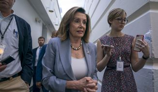 Speaker of the House Nancy Pelosi, D-Calif., arrives for a closed-door meeting with the House Democratic Caucus, Wednesday, Sept. 18, 2019, at the Capitol in Washington. (AP Photo/J. Scott Applewhite) ** FILE **