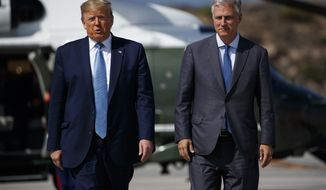 President Donald Trump and new national security adviser Robert O'Brien talk with reporters before boarding Air Force One at Los Angeles International Airport, Wednesday, Sept. 18, 2019, in Los Angeles. (AP Photo/Evan Vucci)