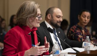 "Cynthia Miller-Idriss, director of International Training and Education Program, School of Education, American University, from left, together with other witnesses Christian Picciolini and Sharon Nazarian, speaks during a House Subcommittee on Intelligence and Counterterrorism hearing on ""meeting the challenge of white nationalist terrorism at home and abroad"" on Capitol Hill in Washington, Wednesday, Sept. 18, 2019. (AP Photo/Manuel Balce Ceneta)"