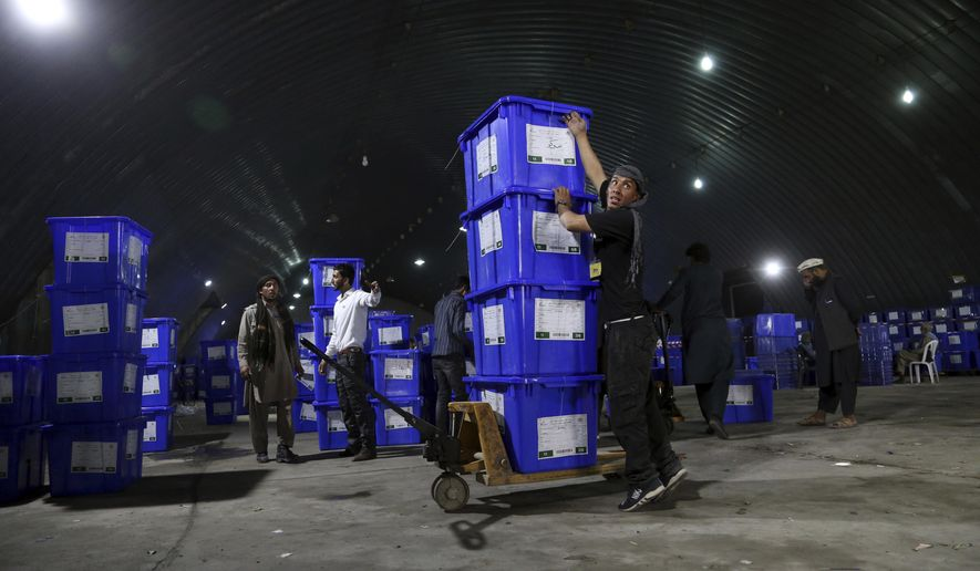 Election commission workers stack ballot boxes in preparation for the presidential election scheduled for Sept. 28, at the Independent Election Commission compound, in Kabul, Afghanistan, Wednesday, Sept. 18, 2019. Afghan officials say around 100,000 members of the country's security forces are ready for polling day. (AP Photo/Rahmat Gul)