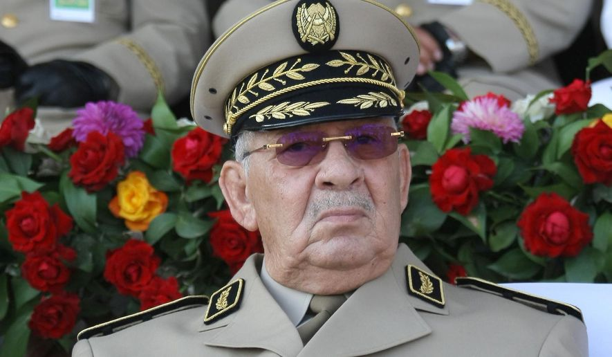 """FILE - In this Sunday, July 1, 2018 file picture Algerian Gen. Ahmed Gaid Salah presides a military parade in Algiers. Algeria's army chief Gen. Ahmed Gaid Salah has ordered Wednesday Sept.18, 2019 gendarmes to block and seize vehicles heading into the capital for weekly demonstrations against the power-structure, claiming that some come with """"malicious intentions"""". (AP Photo/Anis Belghoul, File)"""