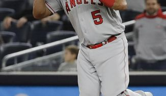 Los Angeles Angels first baseman Albert Pujols celebrates after the Angels' 3-2 win in a baseball game against the New York Yankees on Wednesday, Sept. 18, 2019, in New York. (AP Photo/Frank Franklin II)