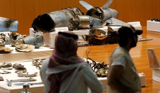 The Saudi military displays what they say are an Iranian cruise missile and drones used in a recent attack on its oil industry at Saudi Aramco's facilities in Abqaiq and Khurais, during a press conference in Riyadh, Saudi Arabia, Wednesday, Sept. 18, 2019. (AP Photo/Amr Nabil)