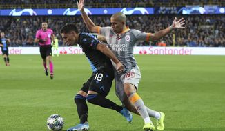 Brugge's Federico Ricca, left, is challenged by Galatasaray's Sofiane Feghouli during the Champions League group A soccer match between Club Brugge and Galatasaray at the Jan Breydel stadium in Bruges, Belgium, Wednesday, Sept. 18, 2019. (AP Photo/Francisco Seco)