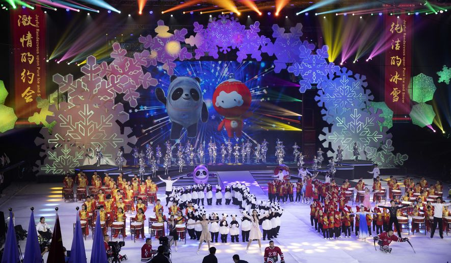 Beijing 2022 Winter Olympic Mascot Bing Dwen Dwen, left on screen and 2022 Winter Paralympic Games mascot Shuey Rong Rong, right on screen are revealed during a ceremony held at the Shougang Ice Hockey Arena in Beijing on Tuesday, Sept. 17, 2019. (AP Photo/Ng Han Guan) ** FILE **