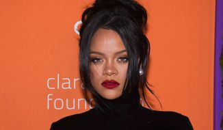 FILE - This Sept. 12, 2019 file photo shows Rihanna at the 5th annual Diamond Ball benefit gala in New York. Rihanna believes women of all shapes, colors and sizes should be celebrated, and that spirit of inclusion has made her lingerie and beauty lines massive successes. Her mission will be showcased Friday as Amazon Prime streams her New York Fashion Week show for Savage X Fenty in more than 200 countries and territories. (Photo by Charles Sykes/Invision/AP, File)