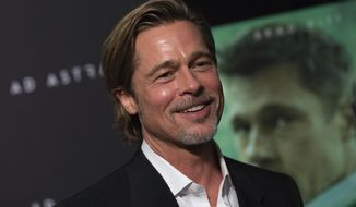 "This Sept. 16, 2019 photo shows actor Brad Pitt at a special screening of ""Ad Astra"" at the National Geographic Museum in Washington. (Photo by Brent N. Clarke/Invision/AP)"