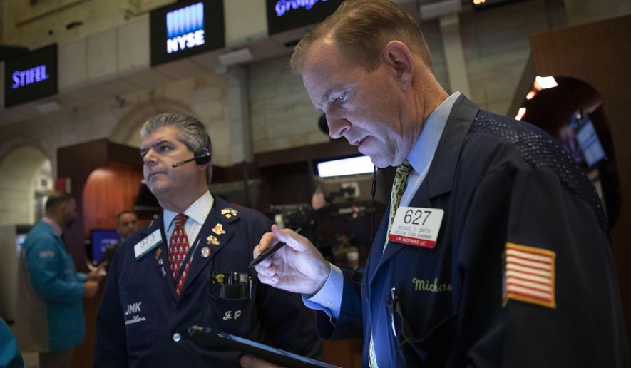 Floor governor Michael Smyth works at the New York Stock Exchange, Wednesday, Sept. 18, 2019. The Federal Reserve is expected to announce its benchmark interest rate later in the day. (AP Photo/Mark Lennihan)