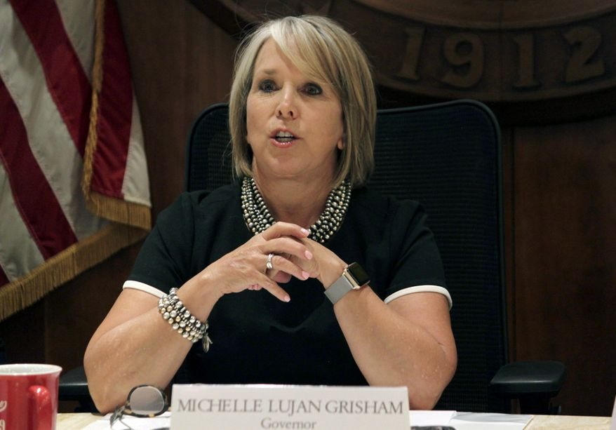 """FILE - In this July 9, 2019 file photo, New Mexico Gov. Michelle Lujan Grisham speaks during a news conference in Santa Fe, N.M. New Mexico's Democratic governor wants to provide free tuition and waive fees for in-state students across the state's network of public universities, colleges and community colleges. The first-year governor announced the proposal for an """"opportunity scholarship"""" on Wednesday, Sept. 18, 2019, at a community college in Albuquerque. It would cover costs not already paid for by federal scholarships and state lottery proceeds. (AP Photo/Susan Montoya Bryan, File)"""