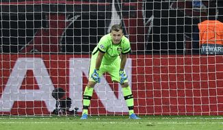 Leverkusen's goalkeeper Lukas Hradecky stands in his goal after he received the second goal during the Champions League Group D soccer match between Bayer Leverkusen and Lokomotiv Moscow at the BayArena in Leverkusen, Germany, Wednesday Sept. 18, 2019. (AP Photo/Martin Meissner)