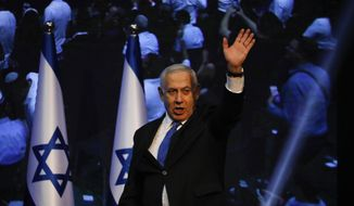 Israeli Prime Minister Benjamin Netanyahu addressees his supporters at party headquarters after elections in Tel Aviv, Israel, Wednesday, Sept. 18, 2019. (AP Photo/Ariel Schalit)