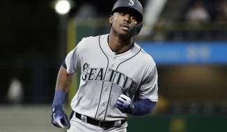 Seattle Mariners' Kyle Lewis rounds third base after hitting a solo home run off Pittsburgh Pirates starting pitcher Dario Agrazal during the fourth inning of a baseball game in Pittsburgh, Wednesday, Sept. 18, 2019. (AP Photo/Gene J. Puskar)