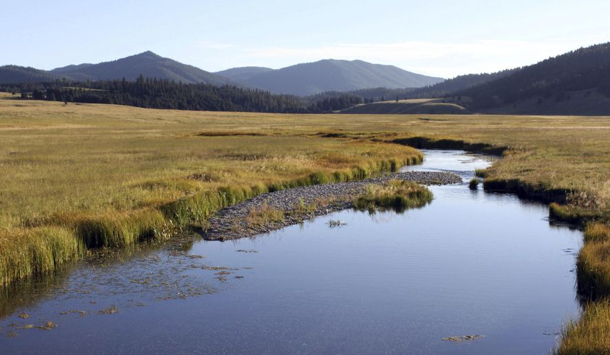 FILE - In this Sept. 3, 2010 file photo, the East Fork of the Jemez River cuts through Valles Caldera National Preserve, N.M. A U.S. district judge on Aug. 31, 2019, denied Jemez Pueblo's claim that its aboriginal property rights to the property were never extinguished, dismissing the pueblo's lawsuit aimed at reclaiming the land. (AP Photo/Susan Montoya Bryan, File)
