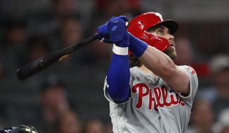 Philadelphia Phillies right fielder Bryce Harper (3) follows through on a two-run home run in the fourth inning of a baseball game against the Atlanta Braves Wednesday, Sept. 18, 2019, in Atlanta. (AP Photo/John Bazemore)