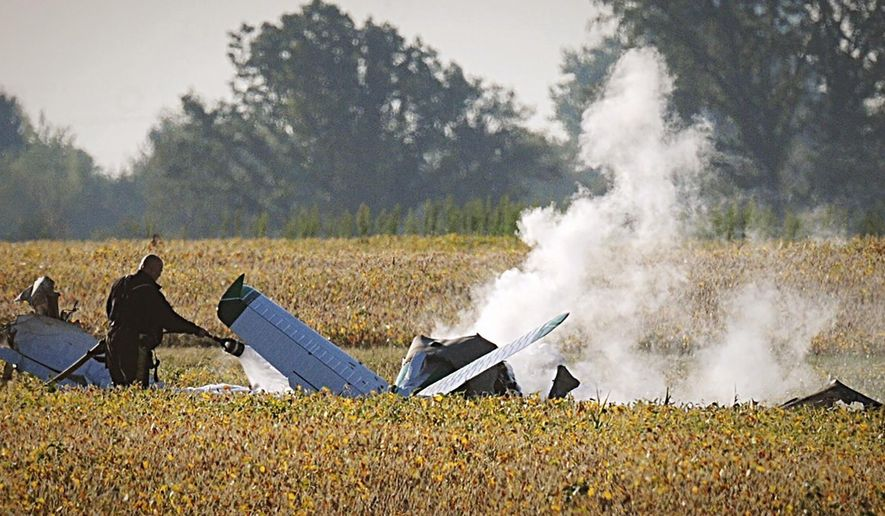 Smoke fills the sky after a fatal plane crash at Madison County Airport Wednesday, Sept. 18 2019 in London, Ohio.   State troopers say one person has died in the crash at a county airport, roughly 30 miles southwest of Columbus, Ohio.  (Marshall Gorby/Dayton Daily News via AP)