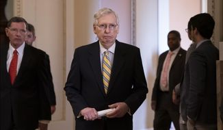 Senate Majority Leader Mitch McConnell, R-Ky., joined at left by Sen. John Barrasso, R-Wyo., arrives to speak to reporters during a news conference at the Capitol in Washington, Tuesday, Sept. 17, 2019. (AP Photo/J. Scott Applewhite)