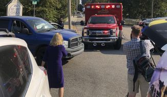 An ambulance leaves the scene shooting in Memphis, Tenn., on Wednesday, Sept. 18, 2019. Officials say two deputies have been injured and a suspect has died in the shooting. (AP Photo/Adrian Sainz)