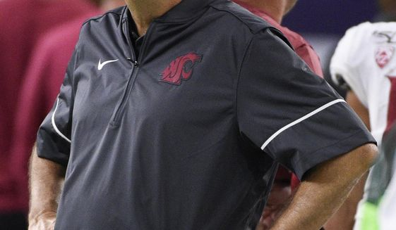 Washington State coach Mike Leach stands along the sideline during the second half of the team's NCAA college football game against Houston, Friday, Sept. 13, 2019, in Houston. (AP Photo/Eric Christian Smith)