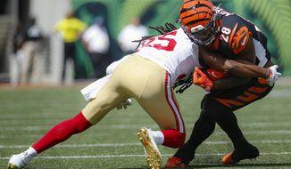 Cincinnati Bengals running back Joe Mixon (28) is tackled on the run by San Francisco 49ers cornerback Richard Sherman (25) during the first half an NFL football game, Sunday, Sept. 15, 2019, in Cincinnati. (AP Photo/Frank Victores)