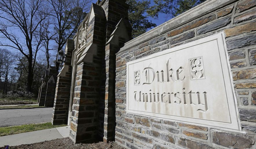 File-This Jan. 28, 2019 file photo shows the entrance to the main Duke University campus in Durham, N.C. Duke University will pay $112 million to settle a whistleblower lawsuit after federal prosecutors said a research technician's fake data landed millions of dollars in federal grants, the school and the government said Monday, March 25, 2019. The private university in Durham submitted claims for dozens of research grants that contained falsified or fabricated information that unjustly drained taxpayer money from the National Institutes of Health, the Environmental Protection Agency and other federal agencies, the U.S. Justice Department said. The school said it is repaying grant money and related penalties.  (AP Photo/Gerry Broome, File)