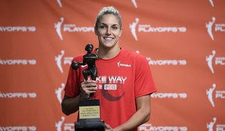 Washington Mystics forward Elena Delle Donne poses with the 2019 WNBA most valuable player trophy at a press conference, Thursday, Sept. 19, 2019, in Washington. (AP Photo/Nick Wass) ** FILE **