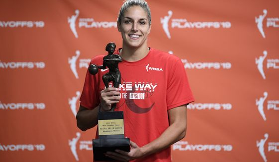 Washington Mystics forward Elena Delle Donne poses with the 2019 WNBA most valuable player trophy at a press conference, Thursday, Sept. 19, 2019, in Washington. (AP Photo/Nick Wass)