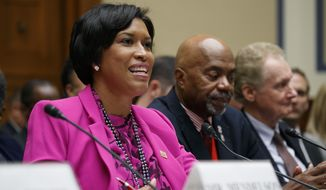District of Columbia Mayor Muriel Bowser, left, testifies next to veteran Kerwin Miller, of Washington, and Roger Pilon, with the Constitutional Studies department of the Cato Institute, during a House Oversight and Reform Committee hearing on statehood for the District of Columbia, Thursday, Sept. 19, 2019, on Capitol Hill in Washington. (AP Photo/Jacquelyn Martin) **FILE**