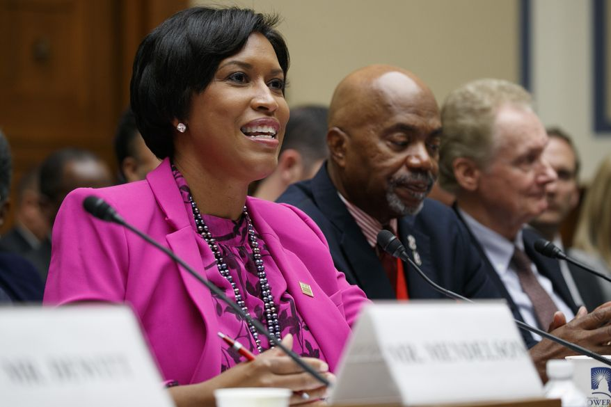 District of Columbia Mayor Muriel Bowser, left, testifies next to veteran Kerwin Miller, of Washington, and Roger Pilon, with the Constitutional Studies department of the Cato Institute, during a House Oversight and Reform Committee hearing on statehood for the District of Columbia, Thursday, Sept. 19, 2019, on Capitol Hill in Washington. (AP Photo/Jacquelyn Martin) ** FILE **