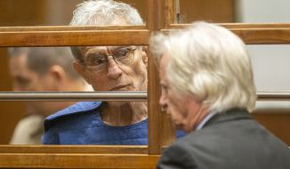 Edward Buck talks with his defense attorney Seymour Amster, right, during an appearance in Los Angeles Superior Court, Thursday, Sept. 19, 2019, in Los Angeles. The prominent LGBTQ political activist was arrested Tuesday and charged with operating a drug house and providing methamphetamine to a 37-year-old man who overdosed on Sept. 11, but survived, officials said. Two other men have died in his apartment since 2017. (AP Photo/Damian Dovarganes)