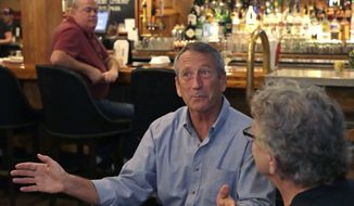 Republican presidential candidate, former South Carolina Gov. Mark Sanford talks with customers at the Puritan Backroom restaurant, during a campaign stop, Thursday, Sept. 19, 2019, in Manchester, N.H. (AP Photo/Elise Amendola) ** FILE **
