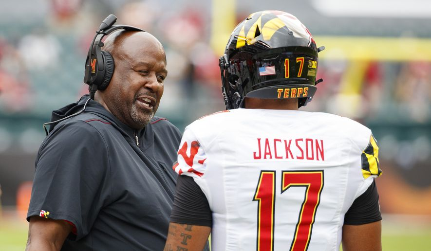 Maryland head coach Michael Locksley talks things over with quarterback Josh Jackson (17) during the first half of an NCAA college football against Temple, Saturday, Sept. 14, 2019, in Philadelphia. Temple won 20-17. (AP Photo/Chris Szagola) ** FILE **