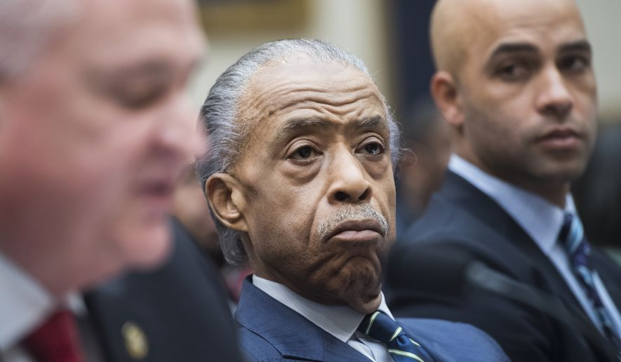 """(From right): James Blake, a former professional tennis player, the Rev. Al Sharpton and Patrick Yoes, national president of the Fraternal Order of Police, testify during the House Judiciary Committee hearing titled """"Oversight Hearing on Policing Practices,"""" in Rayburn Building on Thursday, Sept. 19, 2019. (Photo By Tom Williams/CQ Roll Call via AP Images)"""