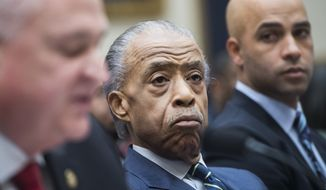 "(From right): James Blake, a former professional tennis player, the Rev. Al Sharpton and Patrick Yoes, national president of the Fraternal Order of Police, testify during the House Judiciary Committee hearing titled ""Oversight Hearing on Policing Practices,"" in Rayburn Building on Thursday, Sept. 19, 2019. (Photo By Tom Williams/CQ Roll Call via AP Images)"