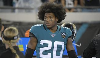 Jacksonville Jaguars cornerback Jalen Ramsey (20) on the bench during the first half of an NFL football game against the Tennessee Titans Thursday, Sept. 19, 2019, in Jacksonville, Fla. (AP Photo/Phelan Ebenhack) ** FILE **