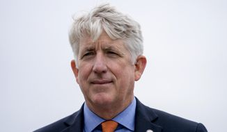 Virginia Attorney General Mark Herring attends a news conference in Washington. (AP Photo/Andrew Harnik, File)