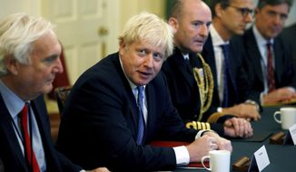 Britain's Prime Minister Boris Johnson meets with Military Service Chiefs at Downing Street in London, Thursday Sept. 19, 2019. (Henry Nicholls/Pool via AP)