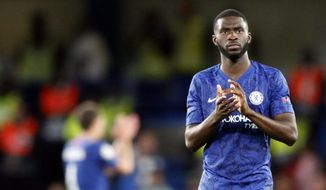Chelsea's Fikayo Tomori applauds to supporters at the end of the Champions League Group H soccer match between Chelsea and Valencia at Stamford Bridge stadium in London, Tuesday, Sept. 17, 2019. (AP Photo/Frank Augstein)