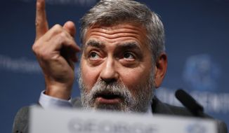 """U.S. actor and activist George Clooney speaks at a press conference about South Sudan in London, Thursday, Sept. 19, 2019. The largest multinational oil consortium in South Sudan is """"proactively participating in the destruction"""" of the country, the actor George Clooney and co-founder of The Sentry watchdog group told The Associated Press this week. (AP Photo/Alastair Grant)"""