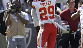 Oakland Raiders tight end Darren Waller carries the ball over Kansas City Chiefs cornerback Kendall Fuller (29) during the second half of an NFL football game Sunday, Sept. 15, 2019, in Oakland, Calif. (AP Photo/Ben Margot)