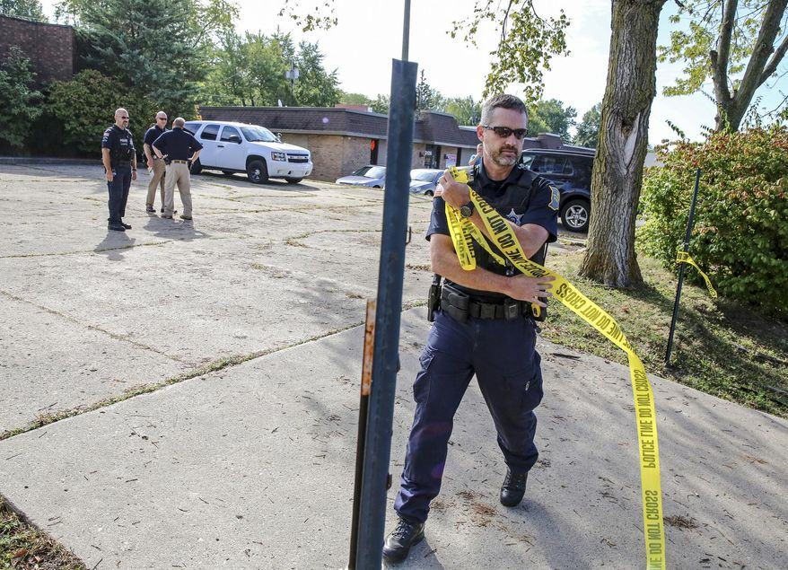 Officers from the Fort Wayne Police Department block the entrance to the site of a former abortion clinic operated by Dr. Ulrich Klopfer on Thursday, Sept. 19, 2019, in Fort Wayne, Ind. After the doctor's death on Sept. 3, more than 2,000 medically preserved fetal remains were found in the garage of his home in rural Crete, Ill. (Eric Ginnard/The Herald-News via AP)