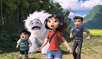 """This image released by DreamWorks Animation shows characters, from left, Peng, voiced by Albert Tsai, Everest the Yeti, Yi, voiced by Chloe Bennet and Jin, voiced by Tenzing Norgay Trainor, in a scene from """"Abominable,"""" in theaters on Sept. 27. (DreamWorks Animation LLC. via AP)"""