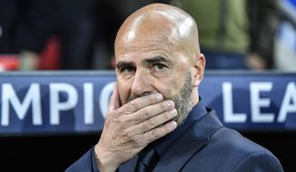 Leverkusen's head coach Peter Bosz reacts prior the Champions League Group D soccer match between Bayer Leverkusen and Lokomotiv Moscow at the BayArena in Leverkusen, Germany, Wednesday Sept. 18, 2019. (AP Photo/Martin Meissner)