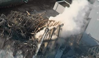 In this March 16, 2011, file photo released by Tokyo Electric Power Co. via Kyodo News, smoke billows from wrecked unit 3 at Fukushima Dai-ichi nuclear power plant in Okuma town, Fukushima prefecture, northeastern Japan. (Tokyo Electric Power Co./Kyodo News via AP, File)