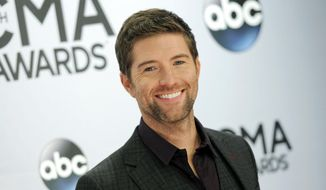 In this Nov. 5, 2014, file photo, Josh Turner arrives at the 48th annual CMA Awards at the Bridgestone Arena, in Nashville, Tenn. Authorities in central California say a passenger bus has crashed while carrying the road crew for the country and gospel singer. Turner and his band were not on the bus. The bus was traveling eastbound on Highway 46 in San Luis Obispo County when it crashed in Shandon late Wednesday night, Sept. 18, 2019. The trip followed a Turner concert at the Vina Robles Amphitheatre in Paso Robles, according to media reports. (Photo by Evan Agostini/Invision/AP, File) ** FILE **