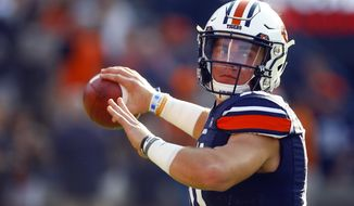 Auburn quarterback Bo Nix (10) warms up before the first half of an NCAA college football game against Kent State, Saturday, Sept. 14, 2019, in Auburn, Ala. (AP Photo/Butch Dill)